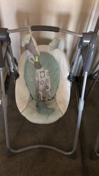 Baby's white and green portable swing 2264 mi