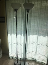 two grey upright floor lamps