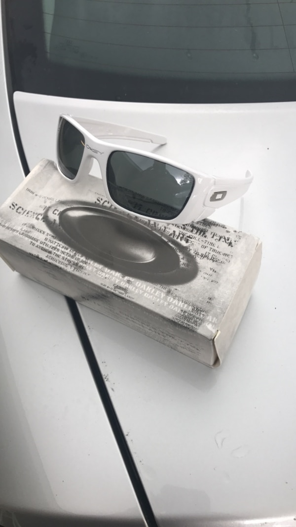 a90e0789ae Used gray tinted white framed Oakley sunglasses with box. Bought second set  for wife but she don t like them. for sale in Daphne - letgo