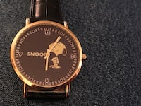 Gold and black snoopy watch