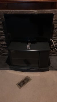 black wooden TV stand with flat screen television Claremont, 28610