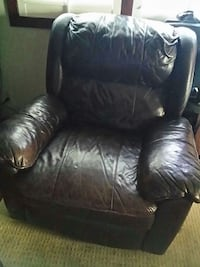 black leather sofa chair with ottoman