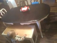 rectangular brown wooden table with chairs 397 mi