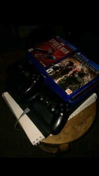 PS4 + 2 CONTROLLERS and 8 Games