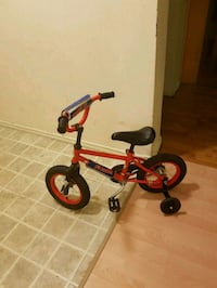 toddler's red and black bicycle with training wheels Edmonton, T6A 1K5