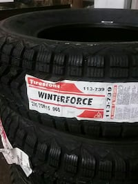 two Winterforce vehicle tires