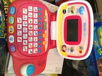 White and red vtech learning laptop Essa, L0M
