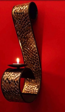 black and gold steel candle holder
