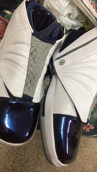 Pair of white-and-blue nike sneakers