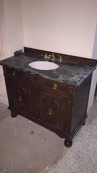Marble and wood Vanity with a sink Toronto, M6B 3E9