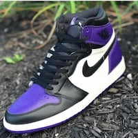 pair of black-and-purple Nike sneakers Charlotte