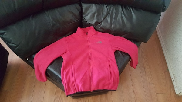 red The North Face zip-up jacket