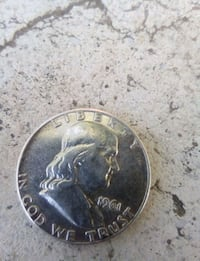 1961 silver-colored Liberty coin