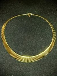 gold-colored choker necklace