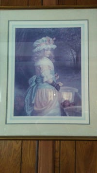 female in pink and white dress with hat painting with brown frame