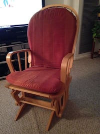 brown wooden red fabric padded glider chair