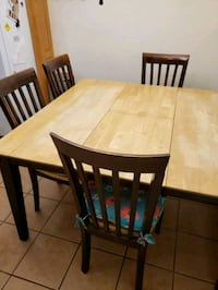 Kitchen table, built in leaf. And four chairs