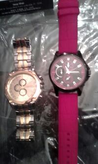 two silver and black chronograph watches