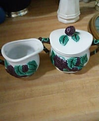 white and green ceramic tea cup
