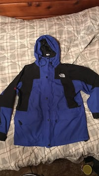 blue and black The North Face zip-up hoodie