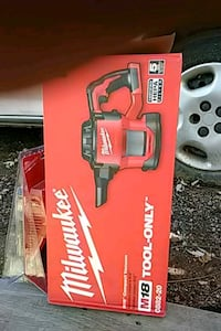 red and black Milwaukee cordless power tool null