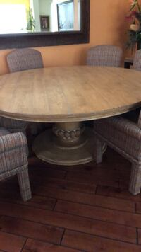 Round brown wooden pedestal table Palm Desert, 92260