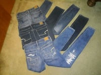 two blue and one black denim jeans Lancaster, 43130
