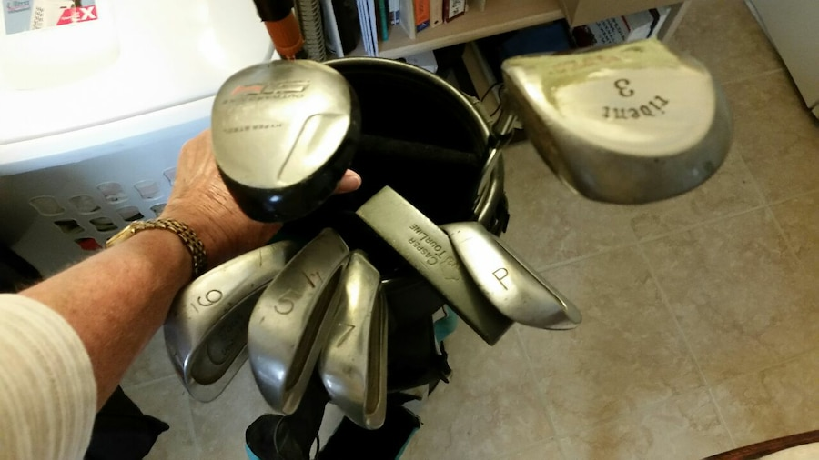 assorted stainless steel golf clubs in teal and bl - $65