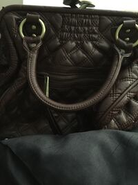 Marc Jacobs. Small scratch on top. Can be fixed Calgary, T1Y