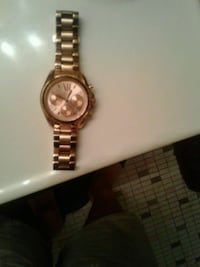 round gold analog watch with link bracelet Washington