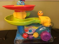 green, yellow, red, and blue Playskool toy