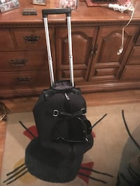 Duffle bag style luggage with wheels.  Excellent condition  Silver Spring, 20904