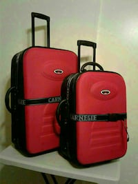 two black and red luggage bags