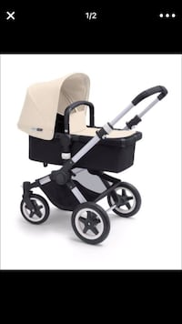 Bugaboo Buffalo Base Stroller base in Aluminum/Black, I also have the bassinet in cream color like you see on the picture. It's used but in very good condition. I have the rain protector cover too if needed.