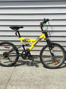 yellow and black full suspension bike