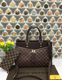 black and brown leather handbag 539 km