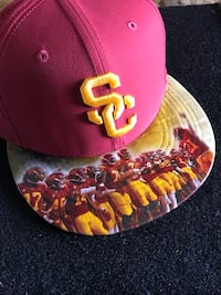 red and yellow baseball cap Costa Mesa, 92627