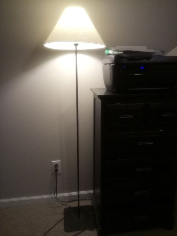 Black floor lamp with foot on/off switch.