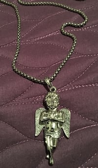 Iced out Jesus, and angel pendants with chains 1623 mi