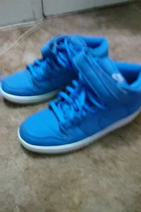 pair of blue-and-white Nike basketball shoes
