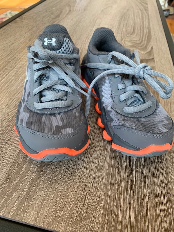 Pair of gray-and-orange Nike running shoes
