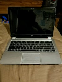 black and grey HP laptop