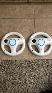 two white-and-blue steering wheel game controllers Des Moines, 50315