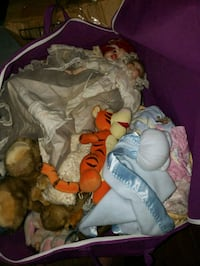 Bag full of porcelain dolls and accessories  Frederick