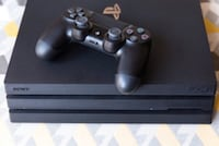 Black sony ps4 pro with controller 1TB memory
