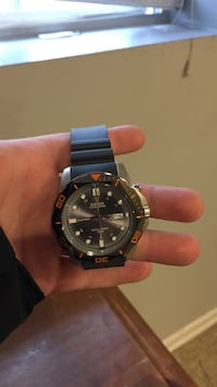 round black Rolex analog watch with silver link bracelet