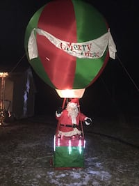 Green and red santa claus on hot air balloon decor