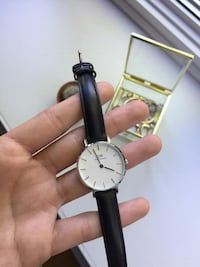 round silver analog watch with black leather strap Laval, H7W 3V7