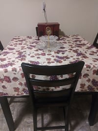 Dark Brown high pub table with 4 leather chairs