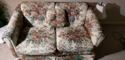 2 seat sofa with one small cushion